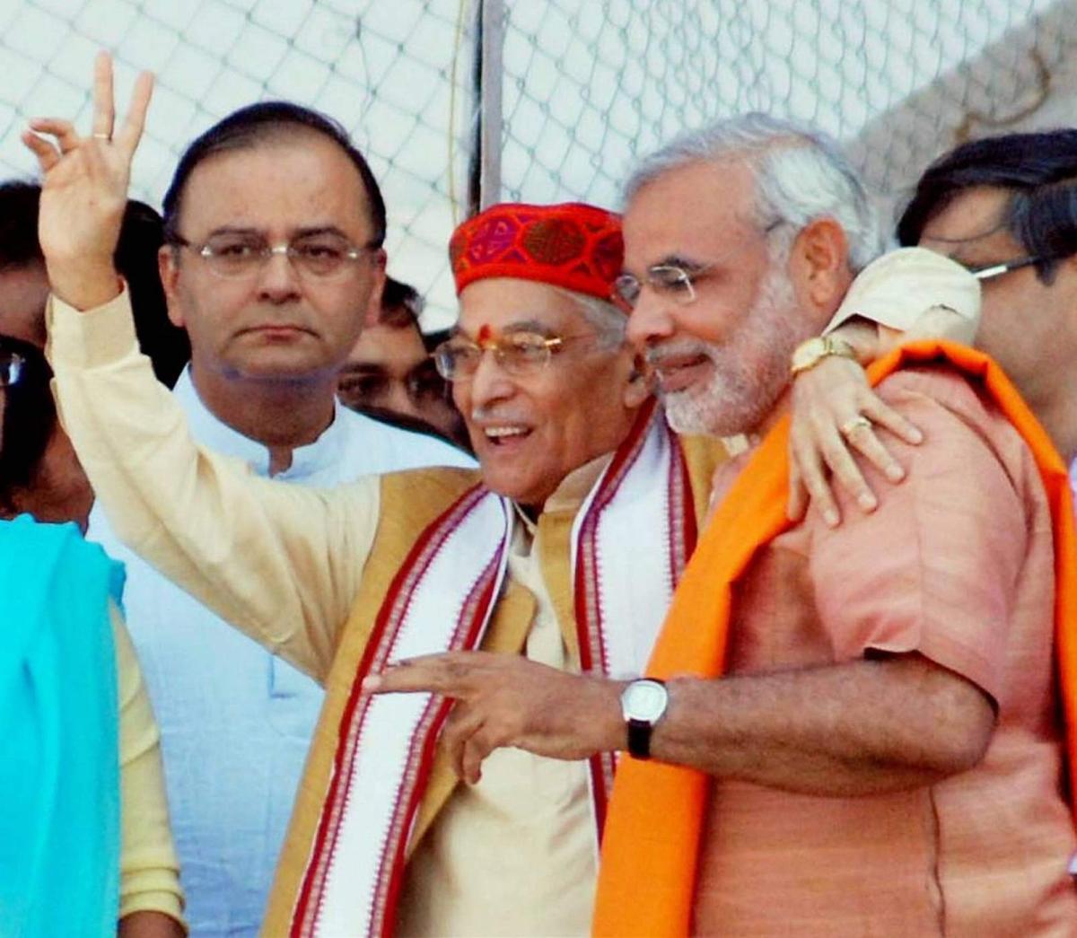 BJP leader Murli Manohar Joshi hugs Narendra Modi, while Arun Jaitley looks on, before the oath taking ceremony of Modi as Gujarat Chief Minister at Sardar Patel stadium in Ahmedabad in 2007.