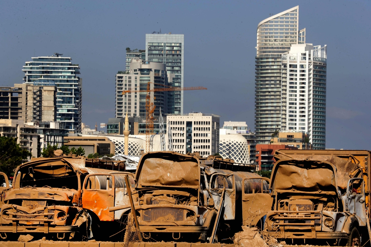 Trucks destroyed by blast are pictured at Beirut port.