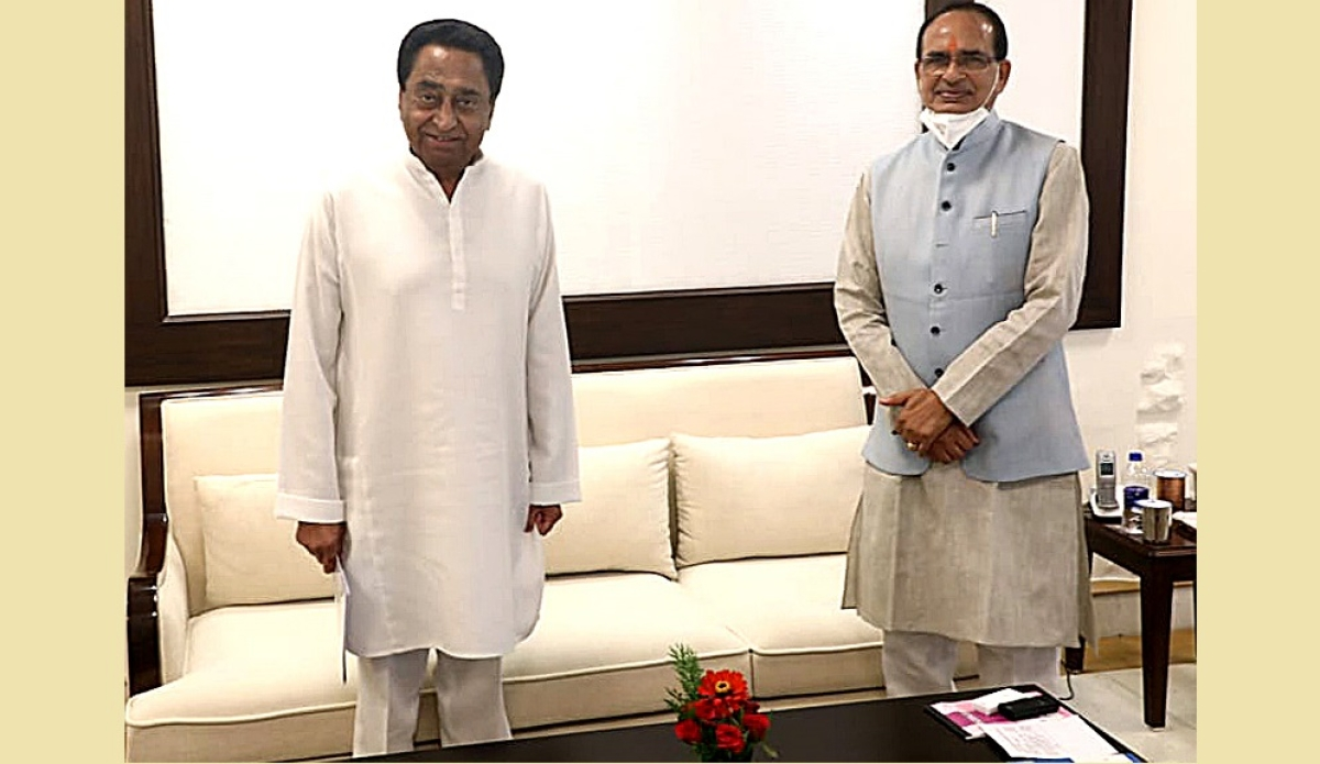 Madhya Pradesh Chief Minister Shivraj Singh Chouhan meets former Chief Minister and Congress State President Kamal Nath at formers residence, in Bhopal on Thursday.
