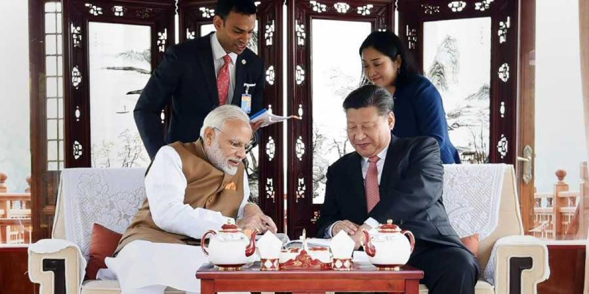 PM Modi enjoys a cup of tea with Xi Jingping