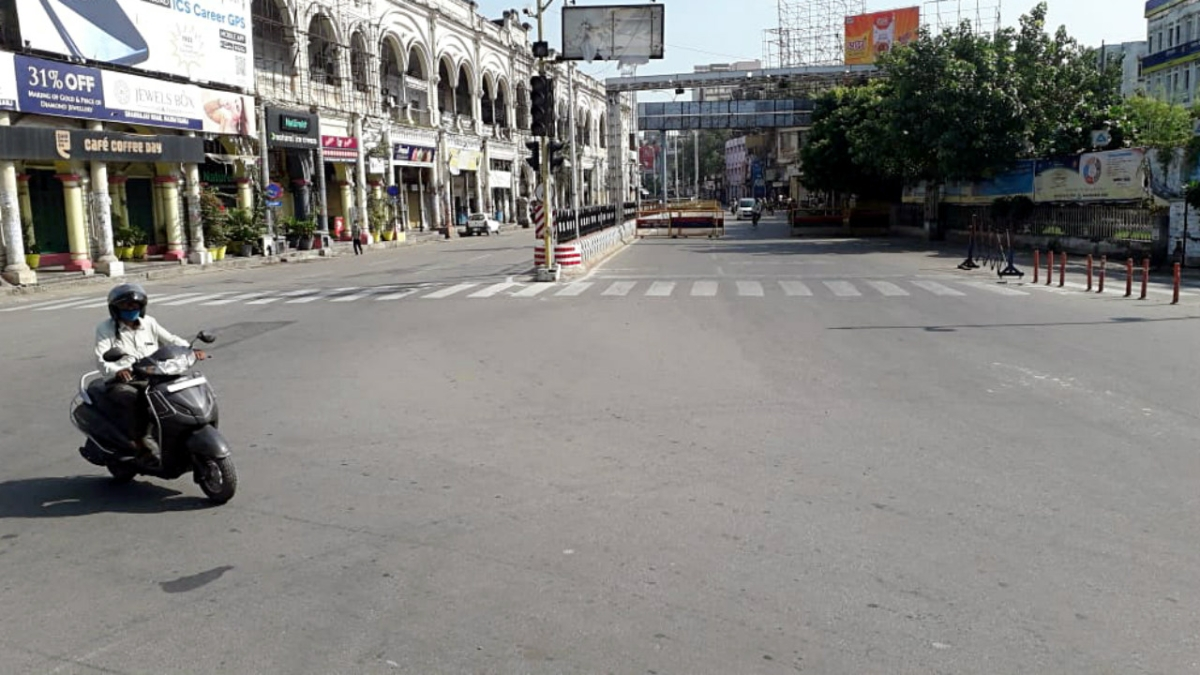 A view of a deserted road during the weekend lockdown in the wake of COVID19 pandemic, in Lucknow on Sunday
