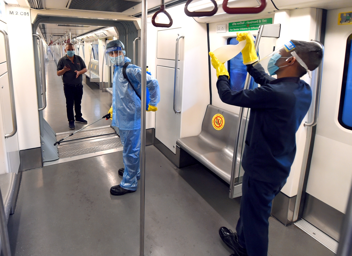 Preparation underway at the metro station as Delhi Metro rail gears up to resume services from Monday as part of Unlock4, in New Delhi on Sunday.