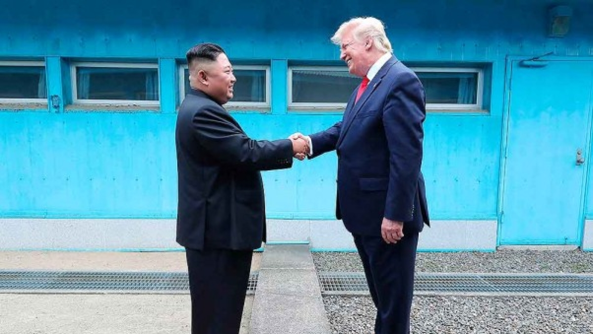 In this photo provided by the North Korean government, North Korean leader Kim Jong Un, left, and U.S. President Donald Trump shake hands over the military demarcation line at the border village of Panmunjom in Demilitarized Zone.