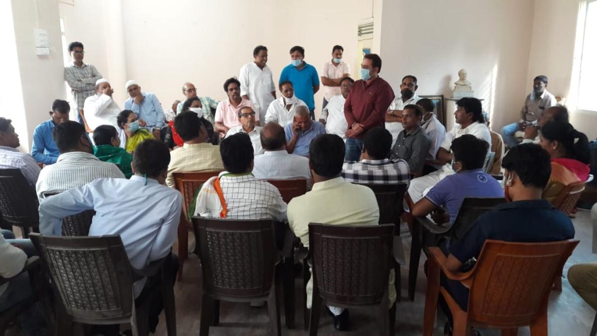 Party members attending  meeting.