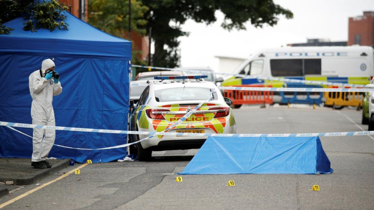 A forensic worker investigates at the scene of reported stabbings in Birmingham, Britain, September 6, 2020.