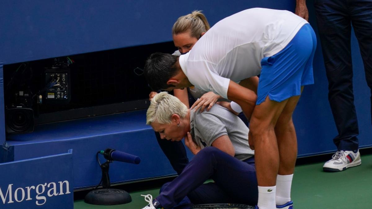 Novak Djokovic with a lineswoman