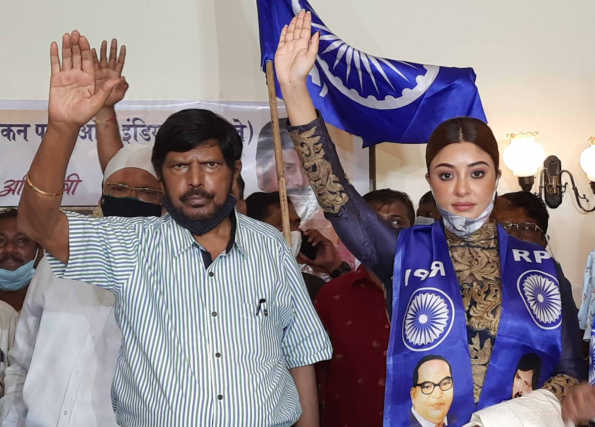 Actor Payal Ghosh with Union Minister Ramdas Athawale as she joins his RPI (A), in Mumbai on Monday.