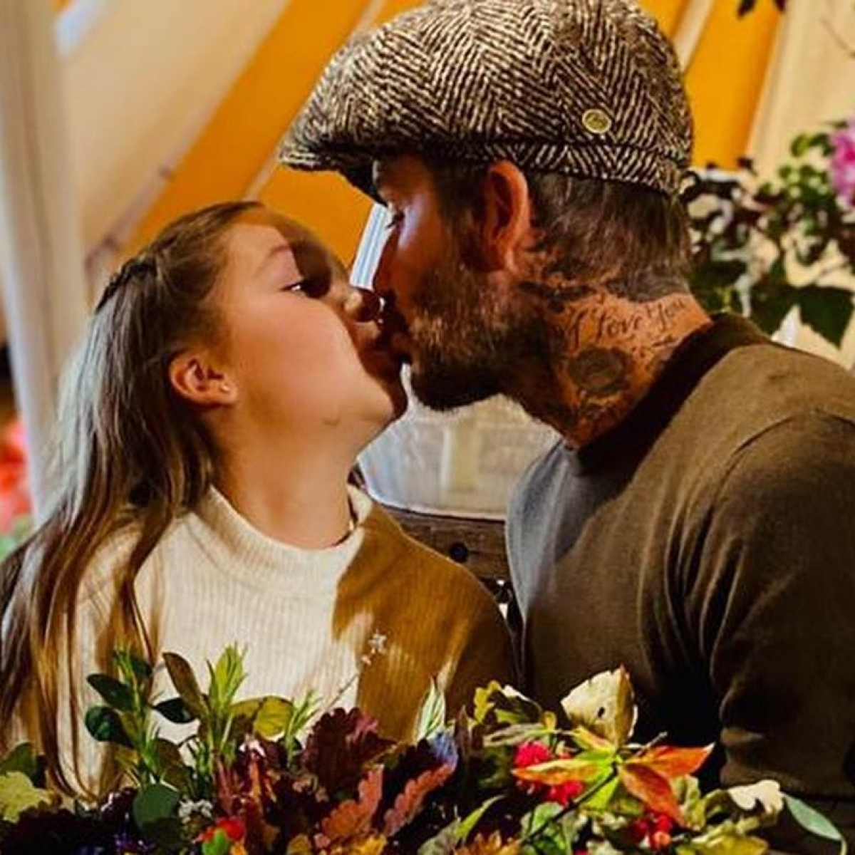 David Beckham fans divided over him kissing 9-year-old daughter Harper on the lips