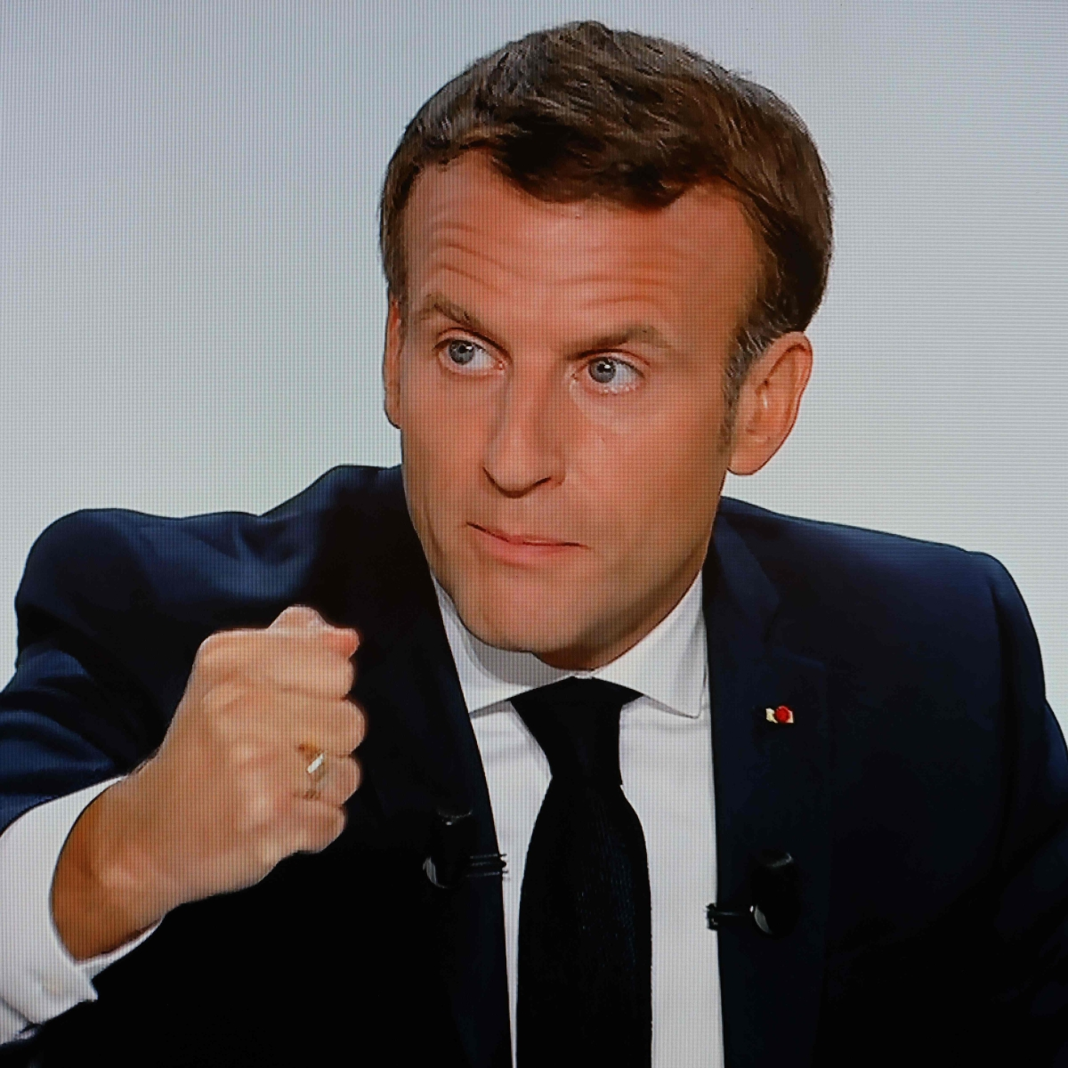 COVID-19 to stay at least until next summer, says Macron