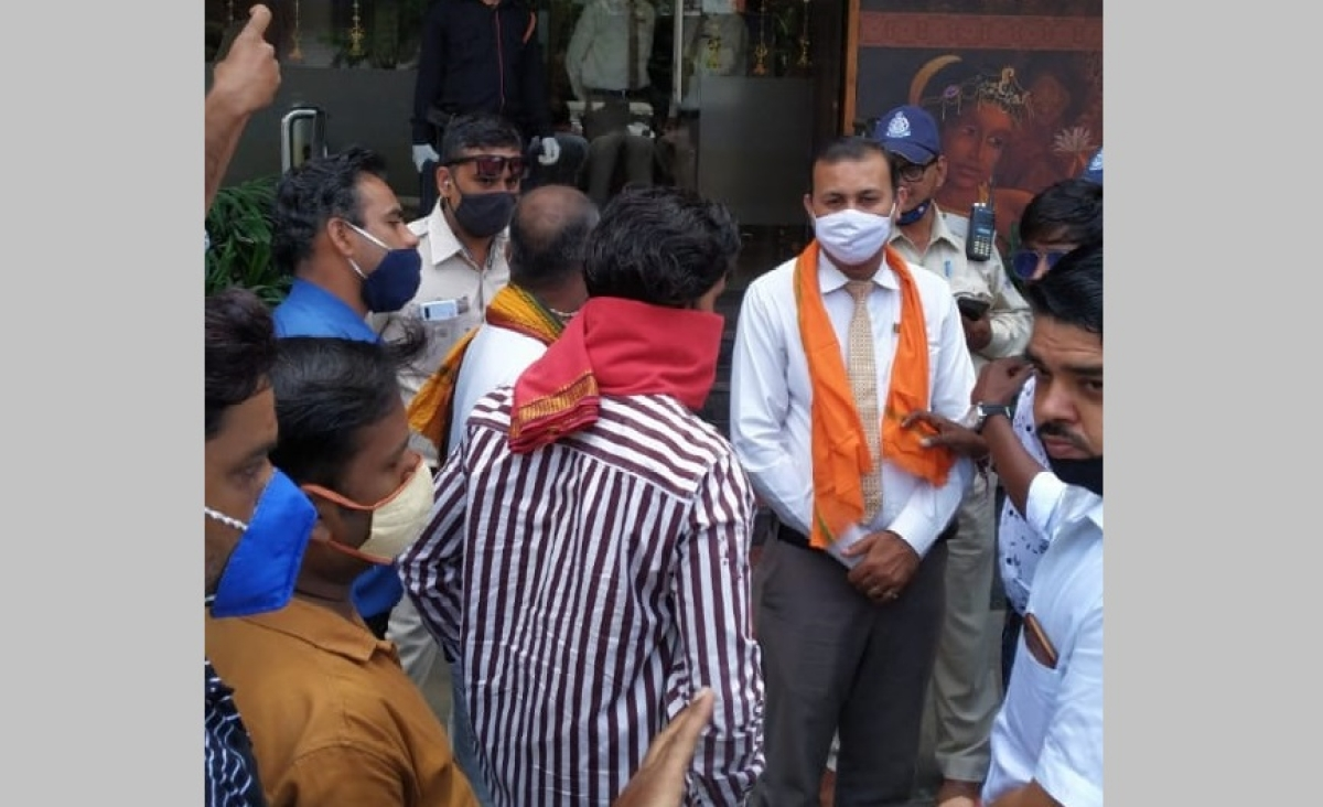 Tanishq Row: Activists of Hindu Jagran Manch demonstrate opposite showrooms of Tanishq in Indore