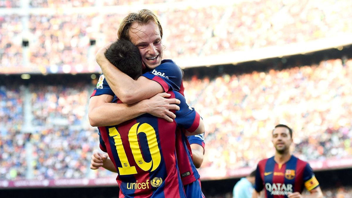 Ivan Rakitic and Lionel Messi