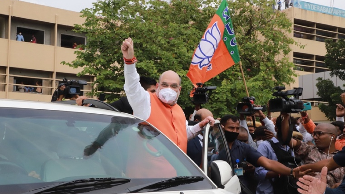 See Pics: Day after Yogi's Hyderabad visit for GHMC polls, BJP raises pitch with Amit Shah's roadshow