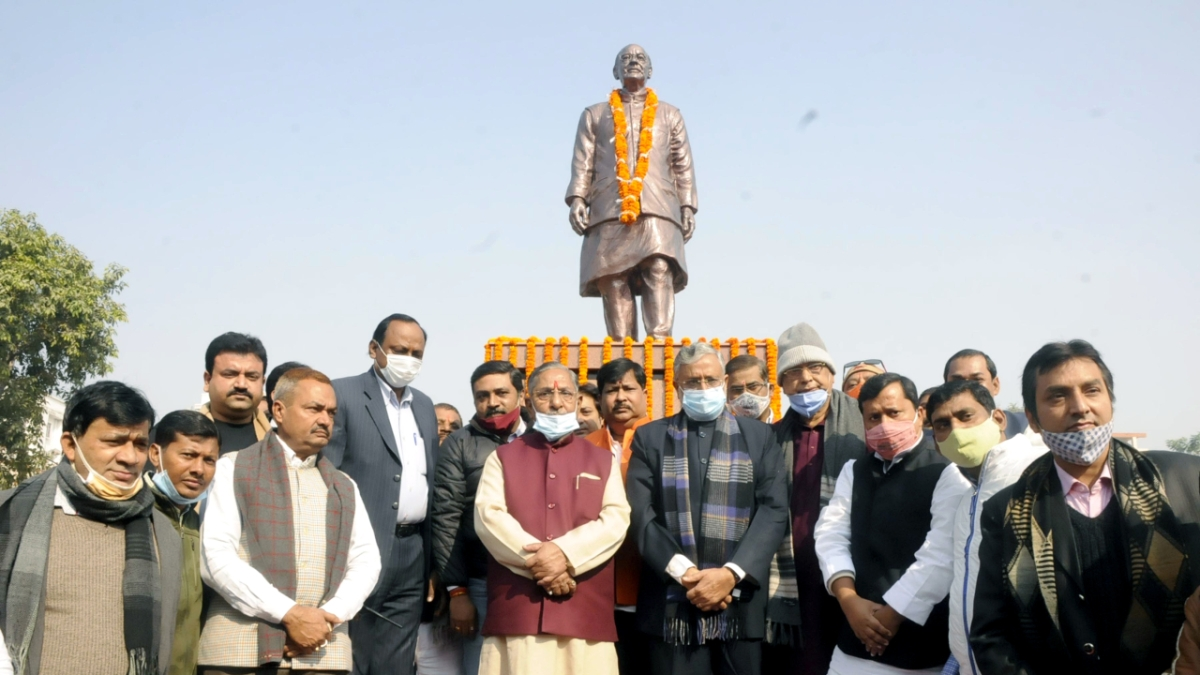 BJP Rajya Sabha Member Sushil Kumar Modi, Ex. Minister Road construction department Nandkoshore Yadav and other party workers pose for photography after pay tribute to late senior BJP leader Arun Jaitley on his birth anniversary at Kankarbagh in Patna on Monday.