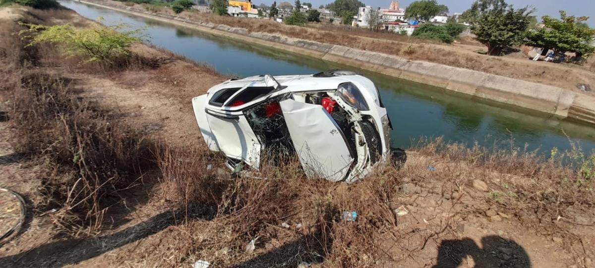 Damaged car near canal