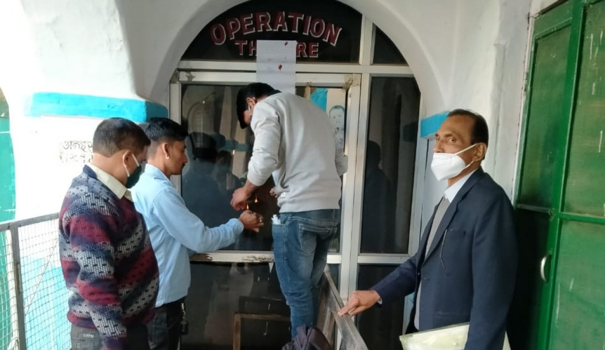 Administration team carrying out sealing operation at Mission Hospital in Jobat village of Alirajpur district
