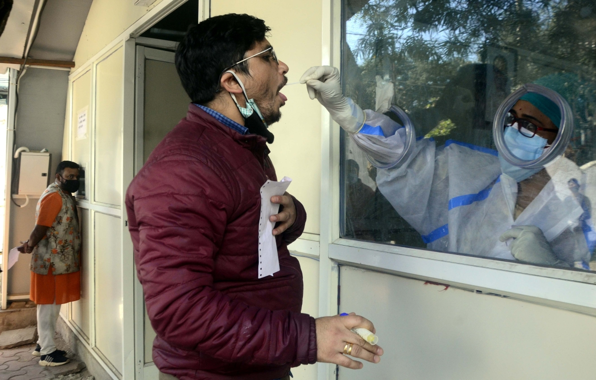 Health worker collects sample for Coronavirus test in Bhopal