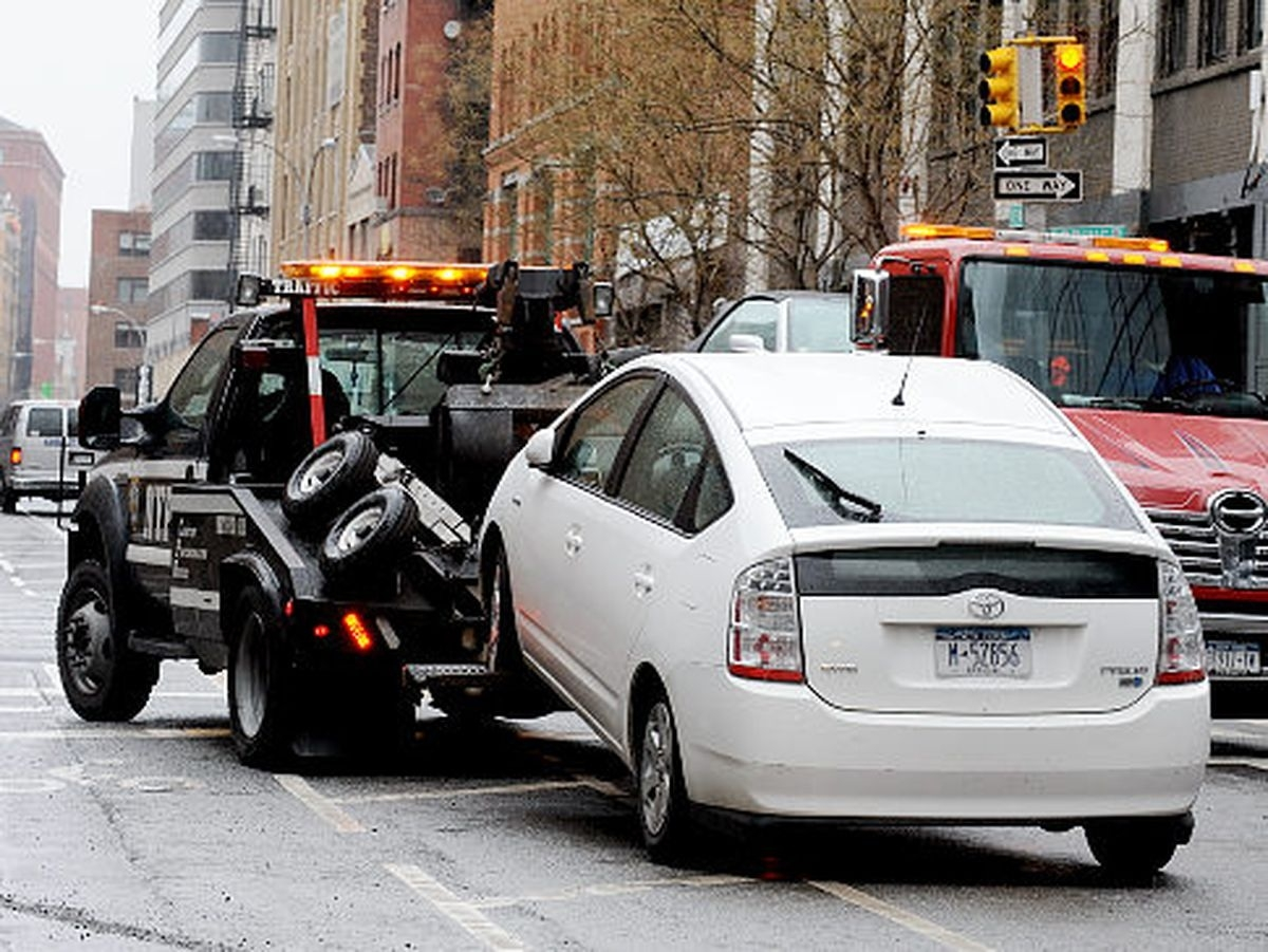 Car towed away with boy in it