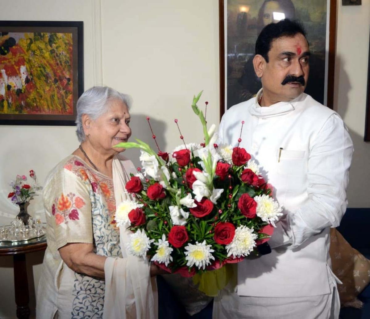 Home Minister Narottam Mishra with Indira Bhaduri