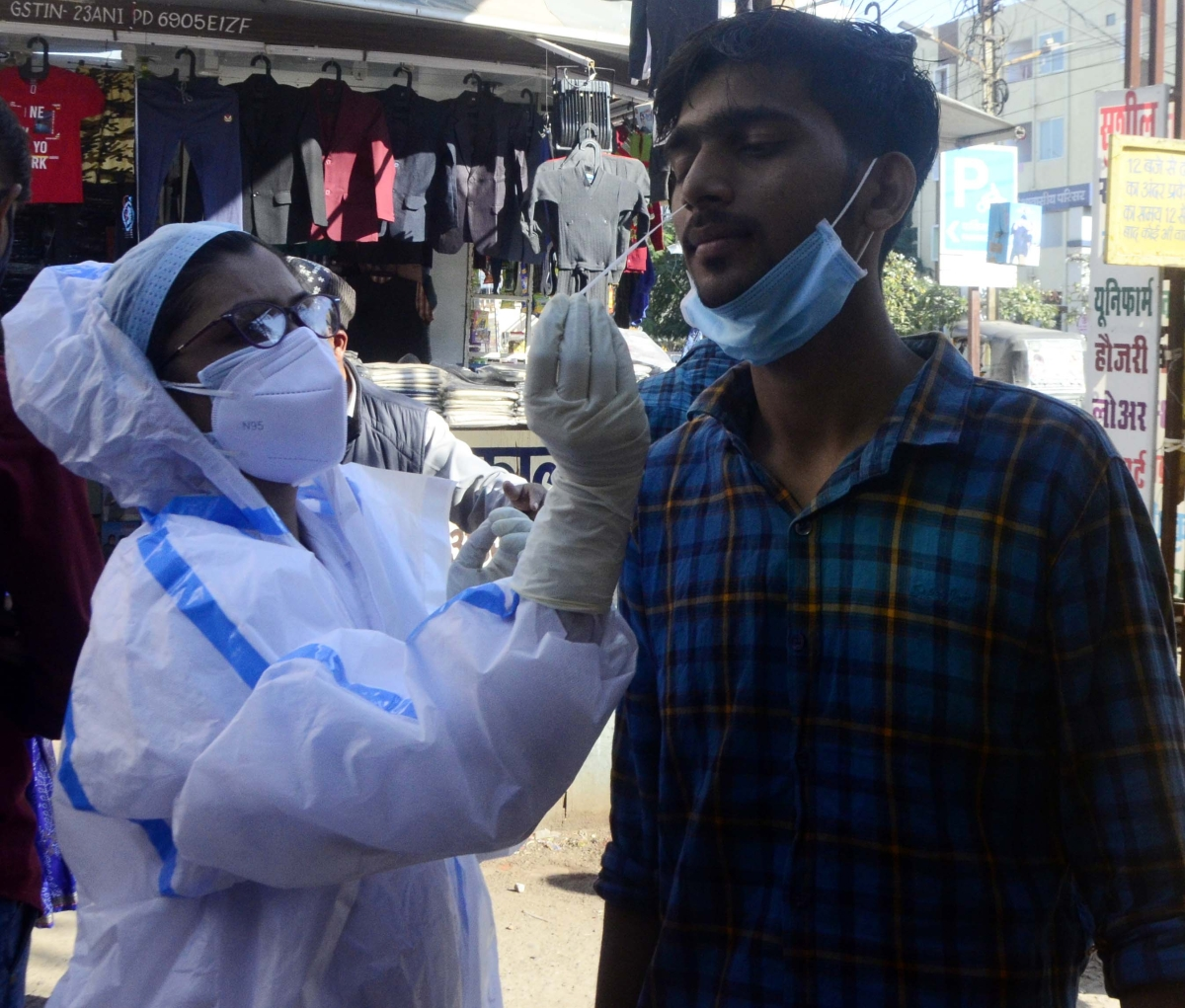 Health worker takes sample for Covid-19 test