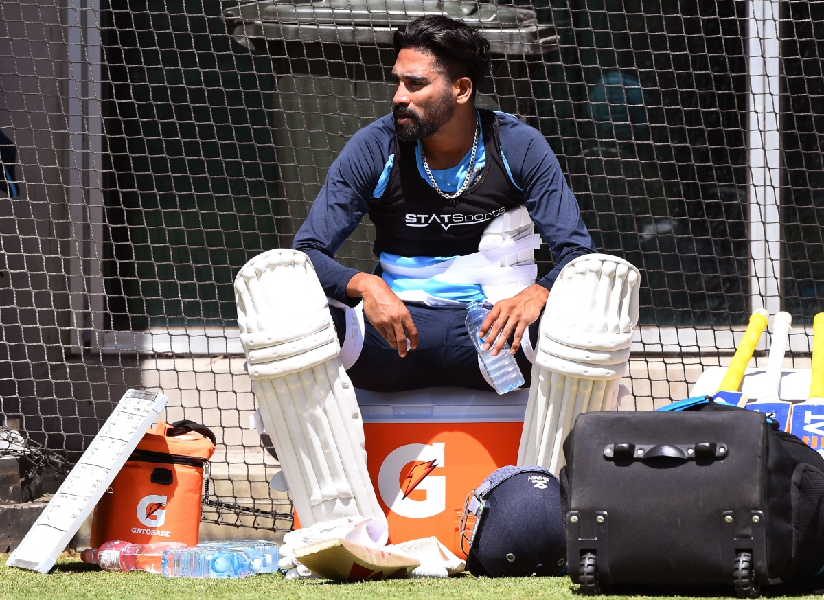India's Mohammed Siraj takes a break during training