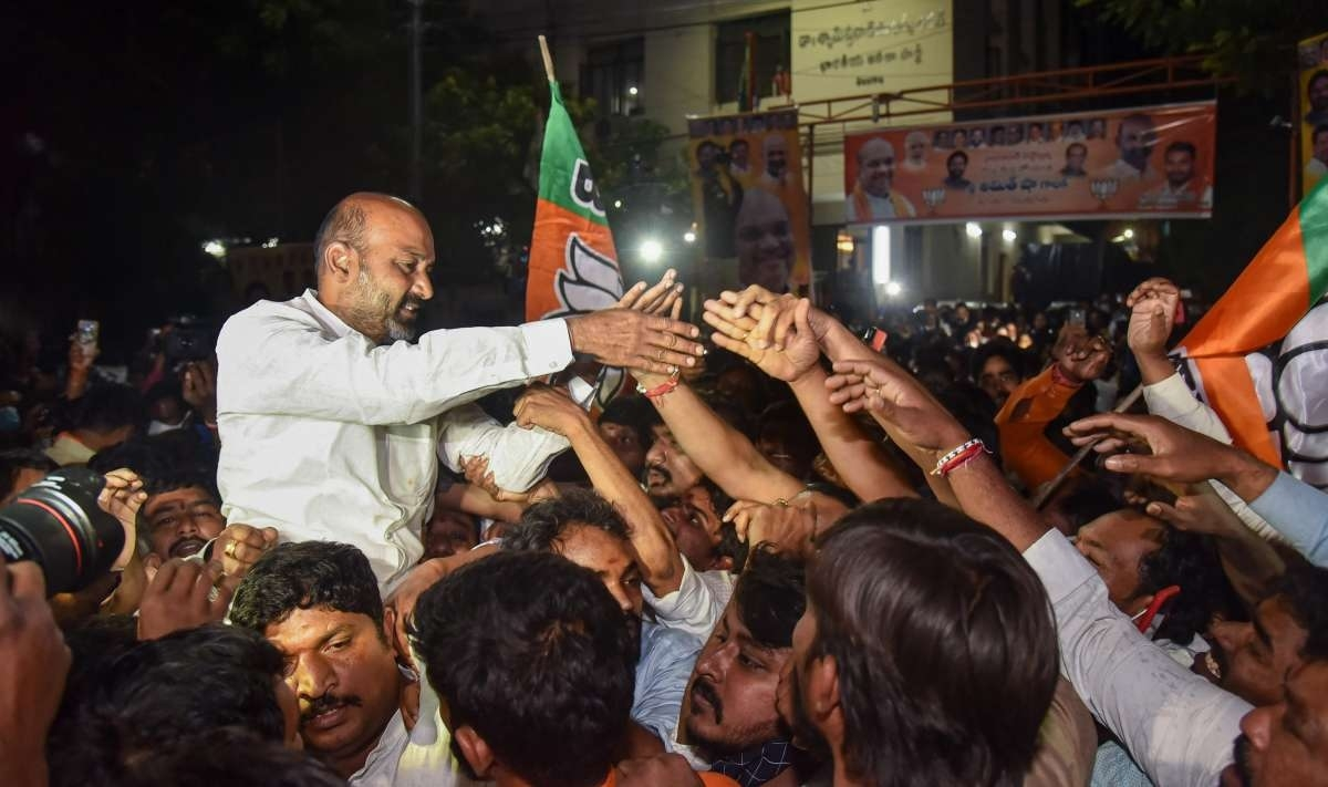 Telangana state BJP chief Bandi Sanjay Kumar celebrates GHMC poll results with party workers in Hyderabad
