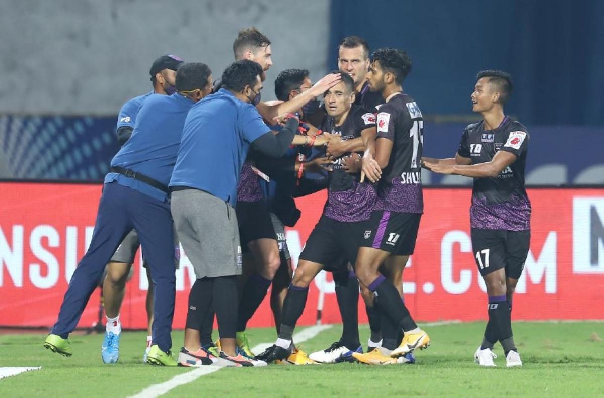 Odisha FC players and coaching staff celebrate after the match