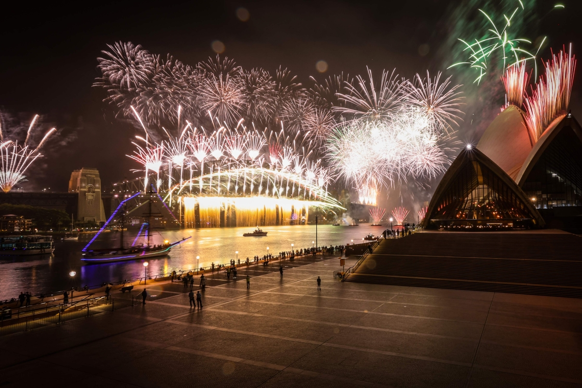 A deserted Sydney Opera House forecourt can be seen in front of fireworks exploding from the Sydney Harbour Bridge during New Year celebrations in central Sydney on January 1, 2021.
