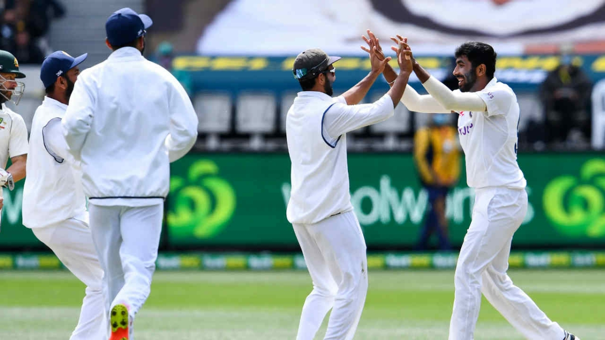Jasprit Bumrah (R) celebrates the wicket of Australias Steve Smith on the third day of the second cricket Test match between Australia and India at the MCG in Melbourne on December 28, 2020