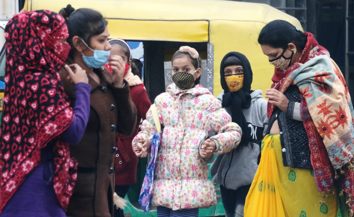 People wrapped up in woolens to beat the cold in Indore on Thursday