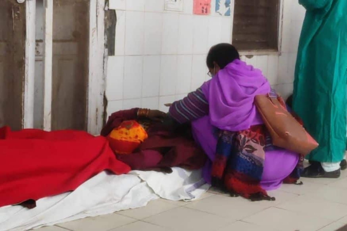 One of the women sleeping on the floor after undergoing sterlisation at  Chhatarpur district hospital.