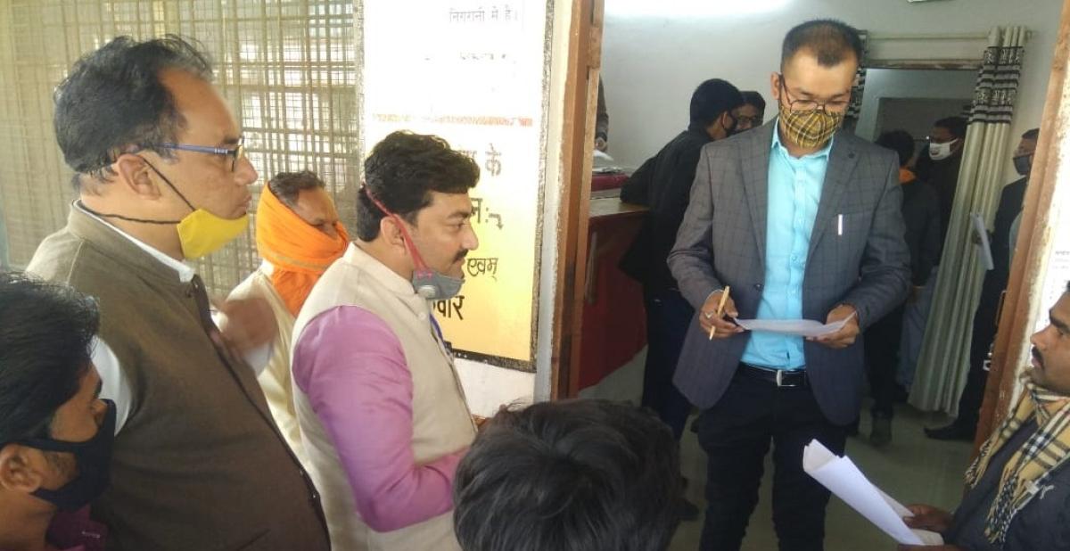 Tribals presenting memorandum to the sub-divisional magistrate Vijay Rai at Sardarpur tehsil office on Thursday