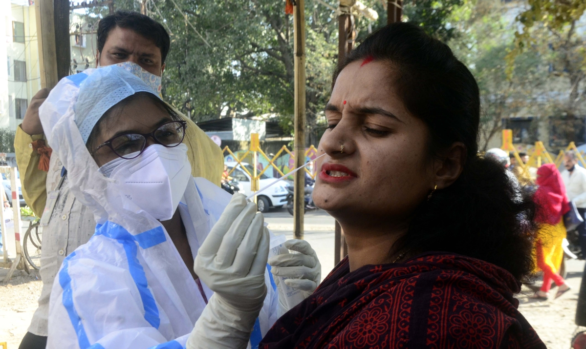 The health worker collects samples for the Coronavirus test in Bhopal on Monday.