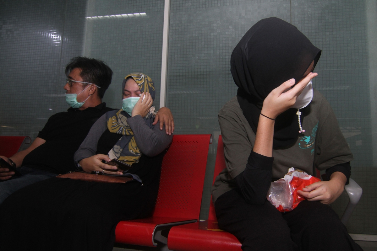 Worried passengers wait for update of their loved ones