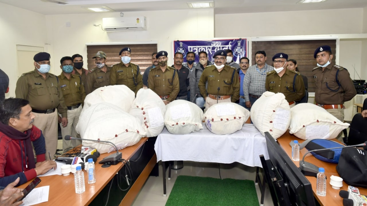 Police with bags containing seized marijuana