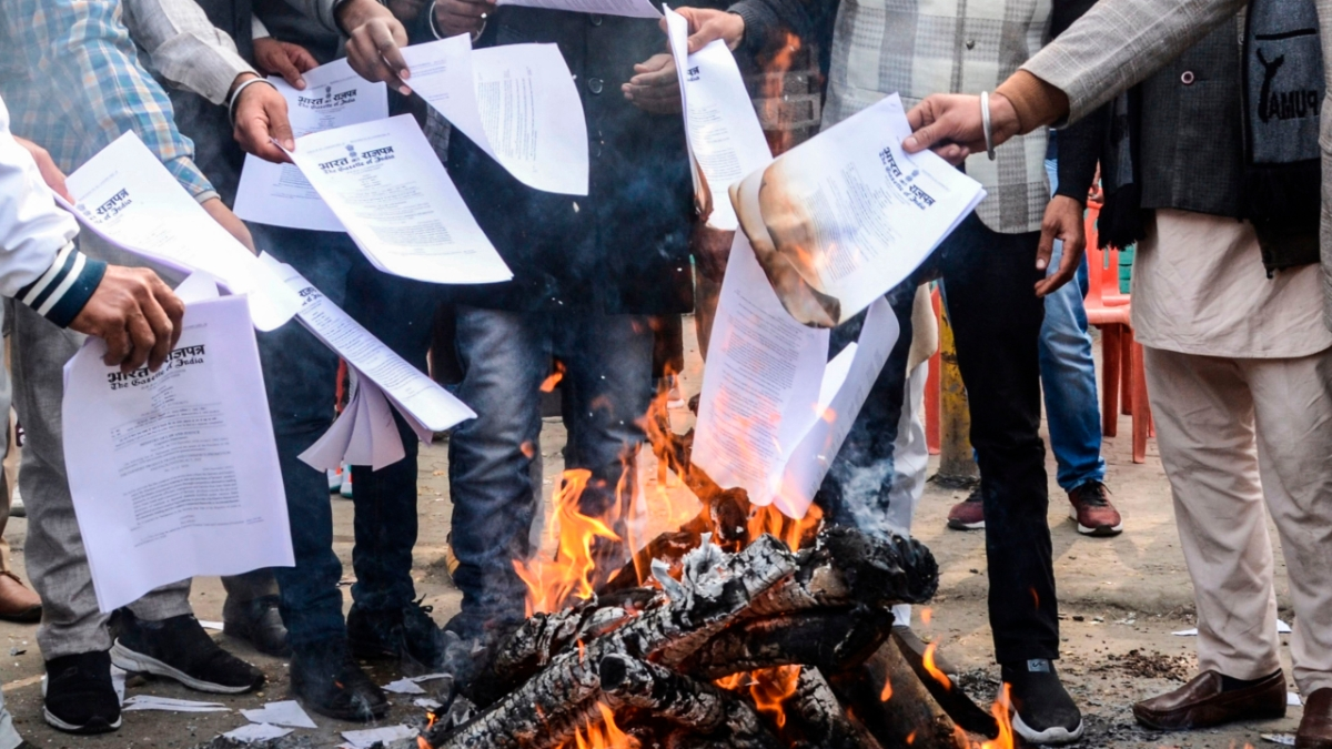 Copies of recent agricultural reforms being burnt during an anti-farm laws demonstration in Amritsar on Wednesday