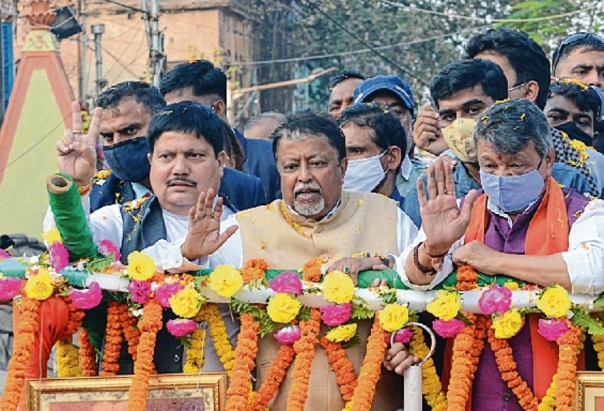 BJP senior leaders Kailash Vijayvargiya, Mukul Roy, Arjun Singh, Rakesh Singh during a road show in Kolkata on Monday.