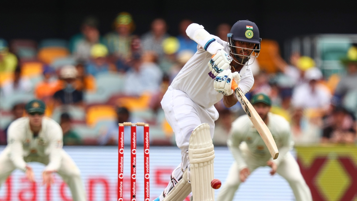 Indias Washington Sundar (C) drives a ball on day three of the fourth cricket Test match between Australia and India at the Gabba in Brisbane