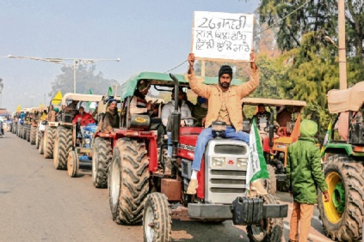 Farmers ride tractors during their protest march in Bathinda, Punjab.