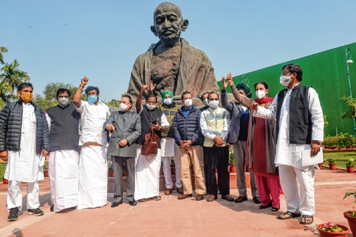 Congress leader Rahul Gandhi and others stage a protest in front of the Mahatma Gandhi statue against farm laws during the Budget Session of the Parliament in New Delhi on Friday.