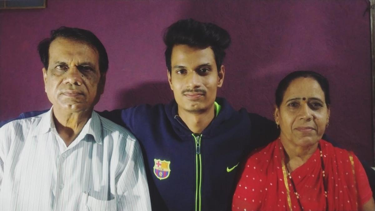 Vijay Sharma (centre) with his parents