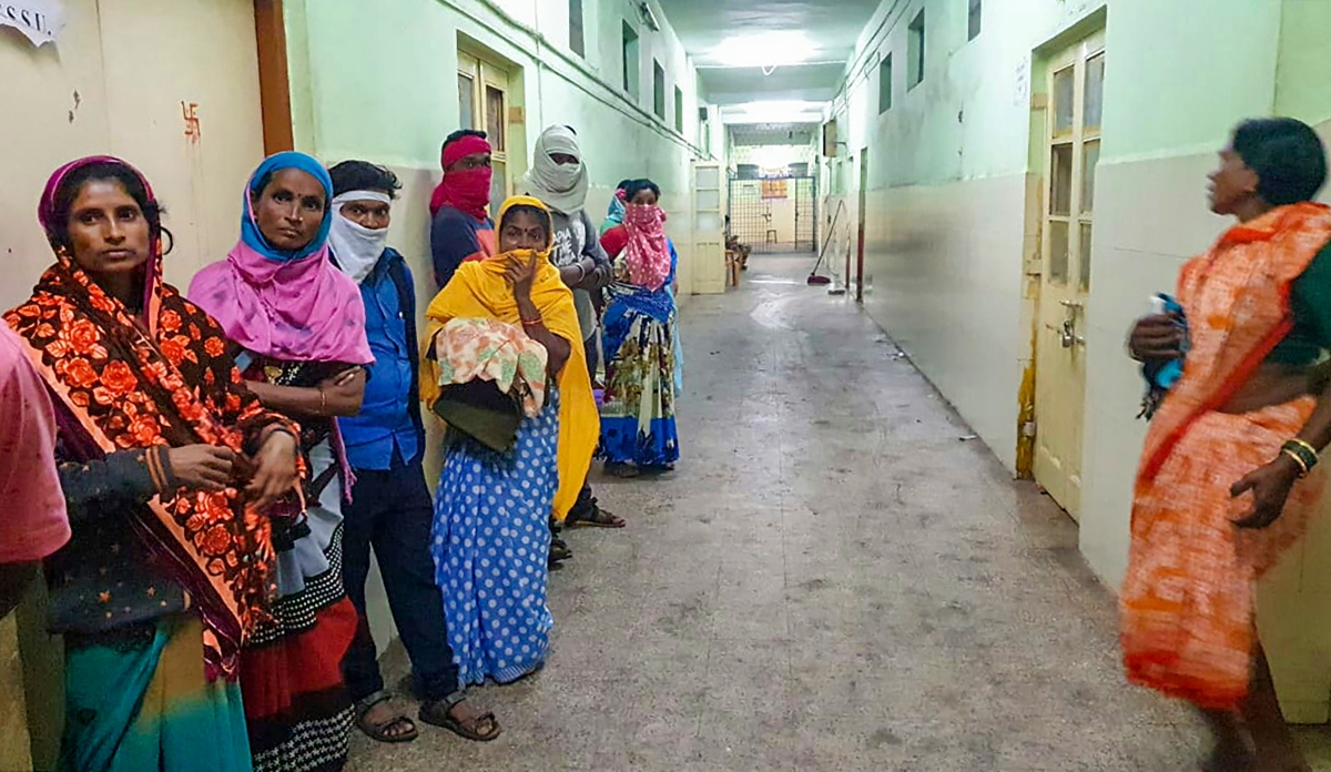 Women wait at Bhandara hospital where 10 babies died in a fire on Saturday