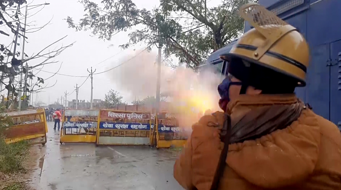 Haryana: Police personnel use teargas to disperse the protesting farmers who gathered where Haryana CM Manohar Lal Khattar will hold Kisan Mahapanchayat, at Kaimla village in Karnal on Sunday.