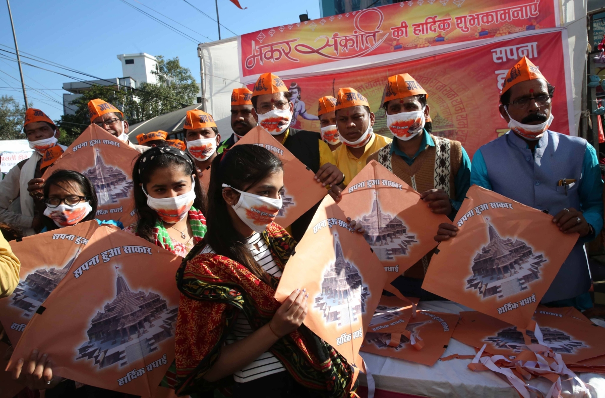 Right wing activists distribute kites depicting Ayodhya's Ram Temple on the eve of 'Makar Sankranti', in Bhopal on Wednesday.