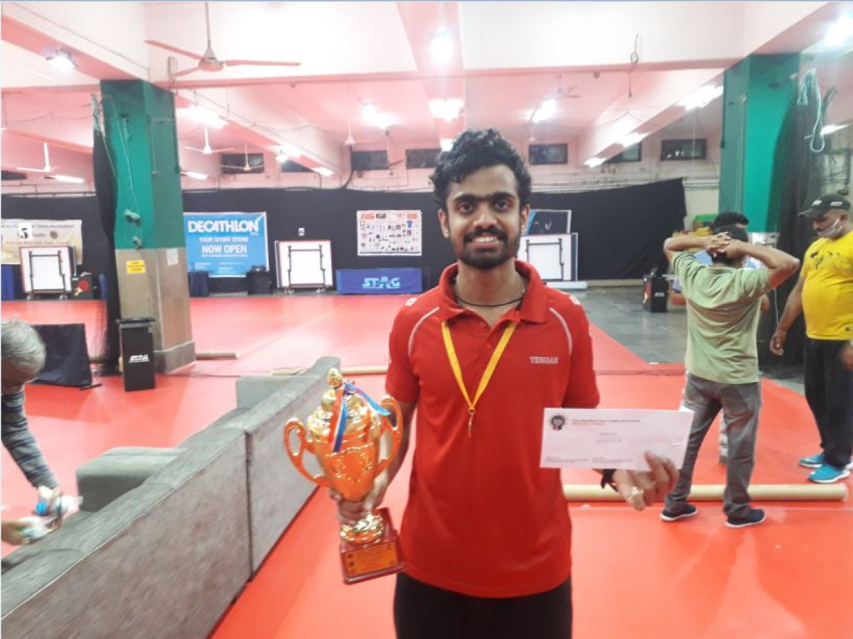Siddhesh Pande with the trophy