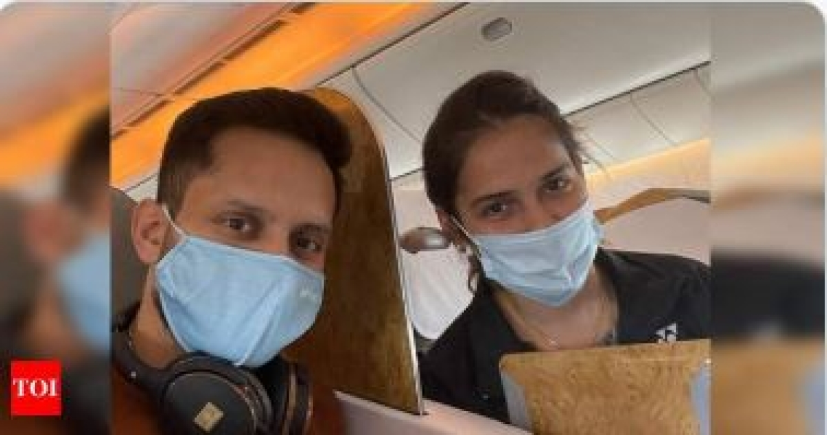 Saina and Company board flight to Thailand