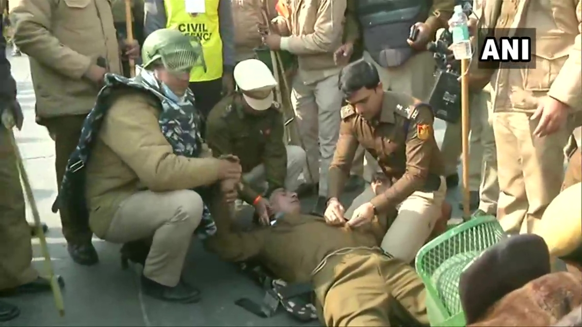 A Delhi Police personnel was looked after by other Police personnel as he fell unconscious while on duty at Dilshad Garden, during the farmers' protest