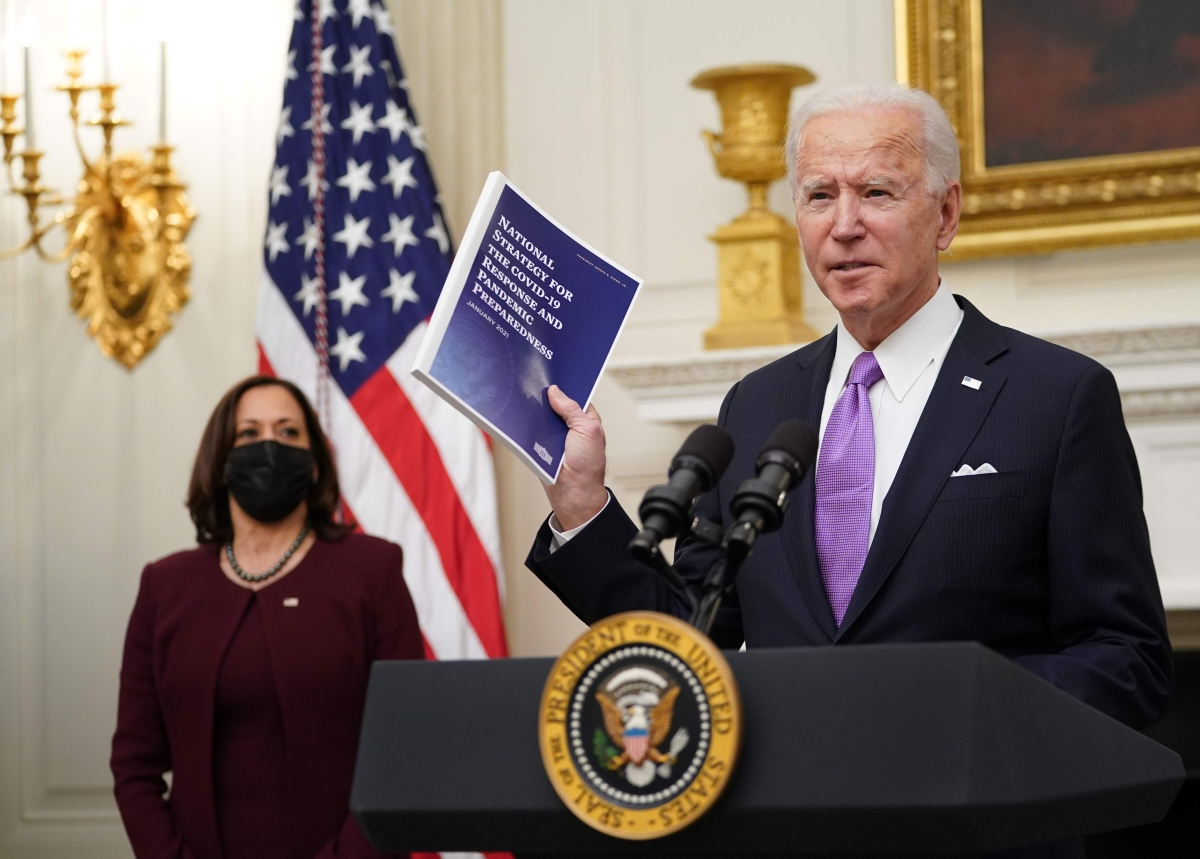 Joe Biden unveils 'wartime' plan to battle COVID-19