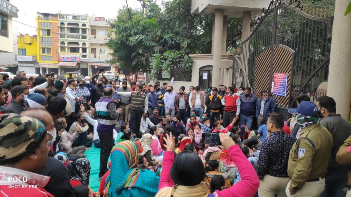 Parents staged a protest by sitting in front of the school urging the management to consider their plea on Saturday