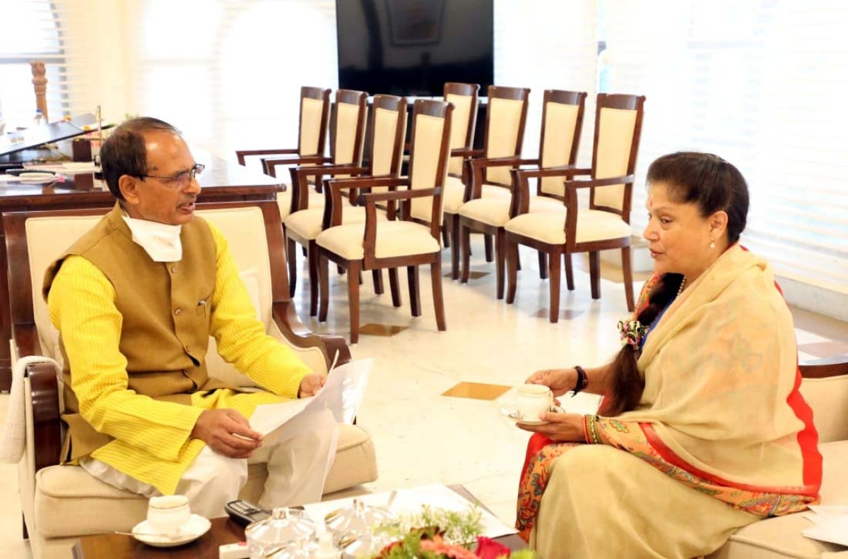 Chief Minister Shivraj Singh Chouhan and minister for sports and technical education minister Yashodhara Raje Scindia at 'Chai Pe Charcha' on Thursday.