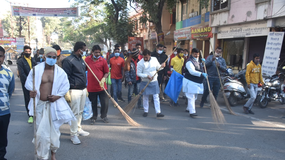 Firojia cleans roads with sanitary workers